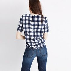 """A tie-front top with buttons all the way down the back for your basic """"party in front, party in back"""" situation. Made of a textural take on our favorite plaid, this shirt is an office-friendly option as easy to toss on as a tee. <ul><li>True to size.</li><li>Cotton.</li><li>Machine wash.</li><li>Import.</li></ul>"""