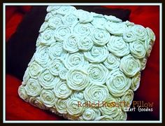 DIY rosette pillow made out of old tshirts.