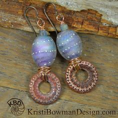*Mystic* Stunning Lampwork Beads swirling with mystical Lavender with Copper Filigree discs roughly wrapped with copper to the bottom. I topped them with a lovely faceted Labradorite bead and a little czech glass bead.