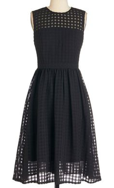 black dress with grid lace overlay