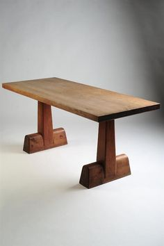 I bought an antique library table the other day that looks just like this!  AXEL EINAR HJORDT TABLE