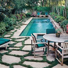 Natural Pool Oasis - Jets - fountain from the garden bed. Sparkling Pools - Southern Living