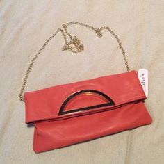 """Small Purse Brand New with tag small purse - color is just like the picture - it has a gold color chain - very stylish and cute from Charming Charlie - got this as a gift but never had a chance to use it - I priced it high for discount shipping - make an offer and I will lower it - dimensions are 11.5"""" long, 6"""" wide Charming Charlie Bags"""