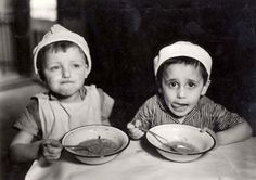 Warasw, Poland, Two children eating in an orphanage on Twarda St. 21 in the ghetto