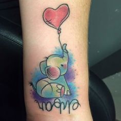 Watercolor Elephant Tattoo - Balloon Tattoo - The Best Elephant Tattoo Designs - Cute Elephant Tattoo Designs and Ideas - Sexy Thigh Tattoo, Small Elephant Tattoo, Elephant Outline, Elephant Tattoo Meanings Realistic Elephant Tattoo, Watercolor Elephant Tattoos, Elephant Tattoo Meaning, Colorful Elephant Tattoo, Cute Elephant Tattoo, Elephant Tattoo Design, Elephant Outline, Small Elephant, Wild Elephant