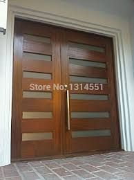 these contemporary front doors are made of mahogany and feature obscure glass with a custom stainless steel pull