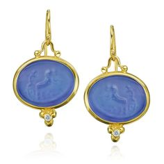 These earrings feature beautiful venetian glass set in fourteen karat yellow gold. The two diamonds totaling .04 carats are a wonderful accent that makes this piece shine.