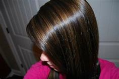 Brunette with some deep lowlights..and lots of shine  ( Must be Aveda Color )