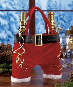 What a cute holiday gift for only $3.95...Santa pants wine carrier!