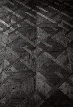 Recycled black parquet flooring by Henry Krokatsis