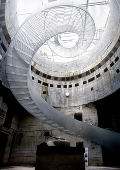 Winding central staircase leading into the tirpitz bunker. Blåvand Bunker Museum' by BIG Architects