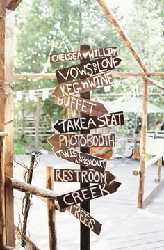 Create rustic wedding signs to direct guests to certain stations.     Image via  Ruffled .