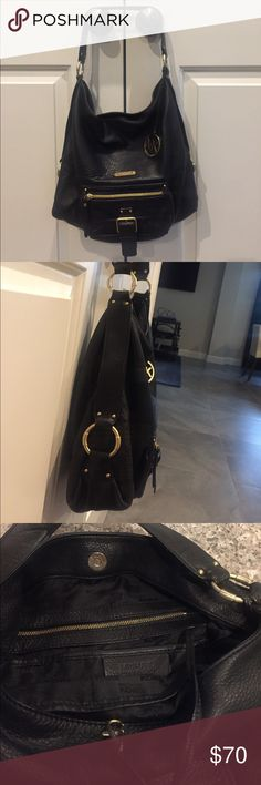 Michael Kors authentic black leather purse Authentic Michael Kors black leather purse with gold accents. Non smoking home. Some wear to shoulder strap. No stains inside of purse. MK dust jacket included. MICHAEL Michael Kors Bags Shoulder Bags
