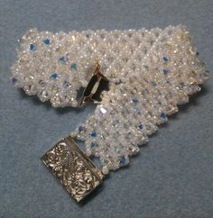 Pattern from Off the Beaded Path on You Tube - Bring on the Bling. Fun pattern with seed beads and crystals.