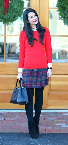 Cute preppy outfit for winter! J.Crew Factory tartan mini skirt with a red crewneck sweater and white oxford shirt, Halogens black sweater tights, and Steven Madden black booties.