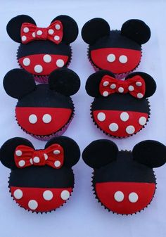 Mickey and Minnie by ~Verusca on deviantART. Made with sugar paste. Ears are made from PVC foam board. There are no instructions on this site but could make a dark chocolate cupcake, red frosting and upside down white choc. chips for dots.  Make your own bow and could use mini Oreo cookies for ears. Cute!
