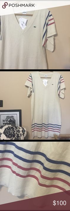 Lacoste soft ivory dress In new, never worn condition.  Ivory with navy and red stripes at sleeves and hem.  Cute worn loose or belted.  Size large but could fit a medium as well.  It would just be more of a baggy fit.  Bust underarms laying flat 20 inches.  Length 36 inches.  Width of sleeves 11 inches and length of sleeves right at 7 inches. Lacoste Dresses Midi