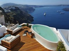 aqua luxury suites in Santorini, voted one of the top 10 island destinations in the world, and most favourite island in Europe