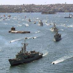 HMAS Sydney leads Australian warships into Sydney Harbour - HMAS Darwin, Perth, Bundaberg, Diamantina and Huon. Australian International Fleet Review, October 2013.