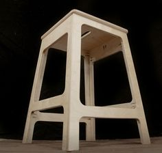 Shop stool made from a half sheet of plywood.