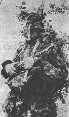 German Soldier with MP 40, the camouflage looks like SS