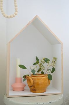 house shaped shelf I want to paint the interior  bright colors!