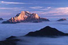 Spunta tra le nuvole il monte Civetta, Dolomites, province of Belluno, Veneto, Northern Italy