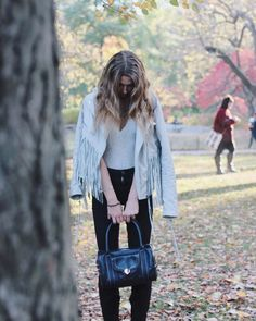 Happily looking down at one of our favorite #ted_baker winter bags. #pursesfornurses #purse #nurse #handbags #happy #love #winter #fringe #leather #tedbaker #uoonyou #urbanoutfitters #vegan #centralpark