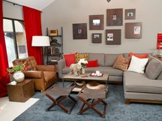 A two-piece sectional allows for plenty of seating in this Tuscan-inspired living space. The bright red curtains, metallic gray open back shelving and leather-tufted chair bring warmth and comfort. The steel and wood coffee table is spruced up with a cement bear, candles and flowers to keep the rustic look alive.