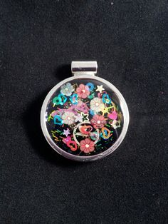 Resin pendant with black glitter as background in silver bezel. PamMcGJewelry https://www.facebook.com/FromTheHeartCustomJewelry