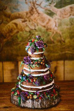 naked wedding cake - photo by Redfield Photography http://ruffledblog.com/whimsical-poconos-woodland-wedding