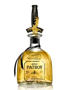Patrón Añejo and it has a David Yurman Bottle Stopper_liquor for swashbuckling tequila fans. Its going to be a hit at my new store :D Patron Tequila, Bottle Stoppers, Whisky, Drinks, Whiskey Bottle, David Yurman, Gold Accents, Samurai, Sword