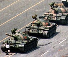 Following a crackdown that resulted in the deaths of hundreds of student demonstrators in Beijing, a lone Chinese protester steps in front of People's Liberation Army tanks in Tiananmen Squarein 1989. At least five photographers captured the event, which became a symbol of defiance in the face of oppression. Charlie Cole, working for Newsweek, won a World Press Photo Award for his version of the image. The identity and fate of the 'Tank Man' remains unclear.