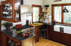 If this new kitchen looks more like a throwback, it's because salvaged woodwork, hardware, and even glass wall tiles from the owner's grandmother's (now-demolished) home were incorporated.