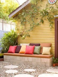 Cheap & easy cinder block bench..maybe we could extend the unused step by the grill and make it a little nook to sit and relax?