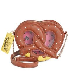 "Snack time! Betsey Johnson's yummy pretzel purse puts a fashionable twist on anything you wear with its clever zipper pull and crossbody strap. | Faux leather | Imported | Crossbody strap with 22"" dro"