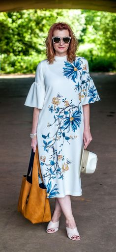 9f9b967d001 Wedding guest or garden party outfit  Marks   Spencer floral midi dress  with flared sleeves   nude cage heel mules   pearl sunglasses. Not Dressed  As Lamb