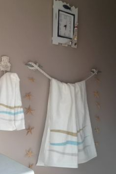 Beach themed bathroom. Decorated myself to surprise nick. Made the towel rack with boat cleats and rope. He really loved it!!