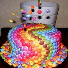 M HEAVEN...I made a similar cake for Jacobs birthday but with boy colors and put the number in m's on top. I love this rainbow look.