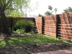Wood fence with horizontal slats