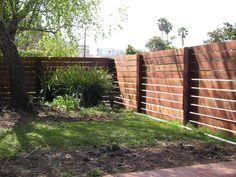 Wood fence with horizontal slats