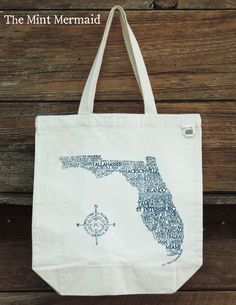 Our #Florida #typography tote bag creates a silhouette of our lovely state using the names of cities throughout the Sunshine State. Screenprinted by hand and designed by us at #TheMintMermaid.