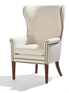 Phillipe Chair from Collection Ten by @ebanistacollect. Wingback chair with rosewood legs and nailhead trim. Upholstered in Ebanista's Lineo Blanco linen. Discover more at www.ebanista.com