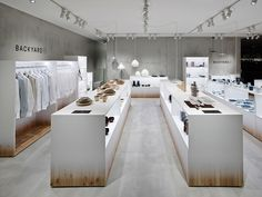 simple clever fixtures.  nendo adds backyard elements to retail space for by   n