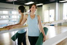 Caucasian woman smiling in yoga studio - stock photo