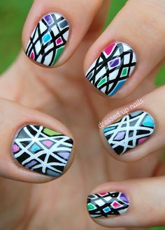 Black & white geometric nails with pops of color  http://www.dressedupnails.com/2012/11/black-white-geometric-nails-with-pops.html#