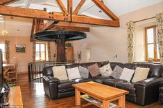 Bargain: A 700-year-old converted corn mill in the Welsh valleys is on sale for just £795,000 and still has the original water wheel in the lounge