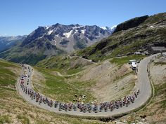 Alpe d'Huez would be amazing to go and see this stage of the Tour de France and see the pros take on this beast.....if i could make it up just a portion of this mountain on my bike i'd consider it a huge accomplishment.