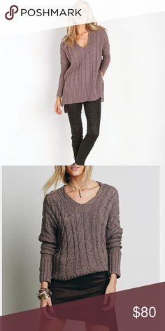NWT FP Easy V cable sweater NWT free people easy v cable sweater in mushroom. This is a reposh, sadly didn't end up fitting me:( Super soft, cozy oversized sweater with side vents and subtle high-low fit. Retails at $128. Feel free to make a reasonable offer! Free People Tops