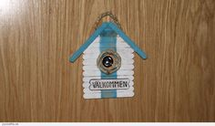 Welcome sign using Popsicle sticks.